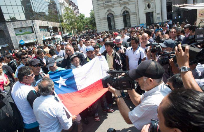 Fotorreportaje de la ciudad después del fallo: agitación en la TV, indiferencia en la calle