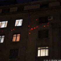 Velatón Laser vuelve a iluminar con arte las huellas de las balas en Paseo Bulnes