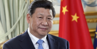 Chinese President Xi Jinping takes part in a meeting with his French counterpart at the Elysee Palace in Paris, on March 26, 2014 in Paris. Xi was set today to sign a series of major business deals on the second day of a lavish state visit to France.  Xi is on his first-ever European tour and after visiting The Netherlands and France will head to Germany and Belgium.   AFP PHOTO POOL CHRISTOPHE ENA