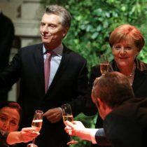 Merkel y Macri coinciden en todo menos en el fútbol
