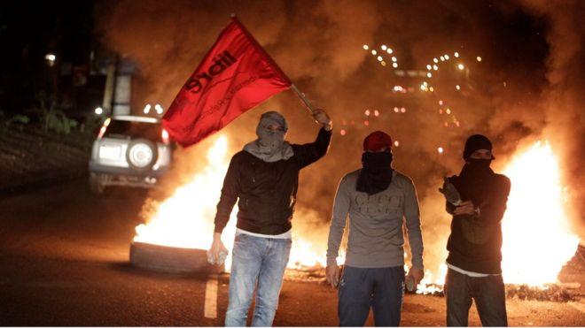 """""""Mucha gente siente rabia"""": la tensión e incertidumbre con que Juan Orlando Hernández asume su segundo mandato en Honduras"""