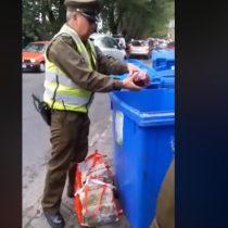 Indignación en redes sociales por carabinero que bota frambuesas al basurero