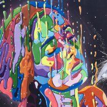 """Mural """"Amor"""": mujer pintada en 9 metros con 130 colores"""