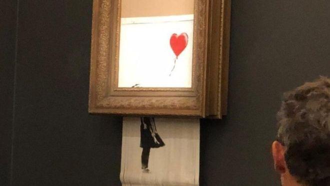 Obra de Banksy se autodestruye tras subastarse por más de un millón de dólares