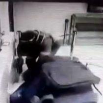 Registran brutal golpiza a guardia tras intento de robo a banco en Puente Alto