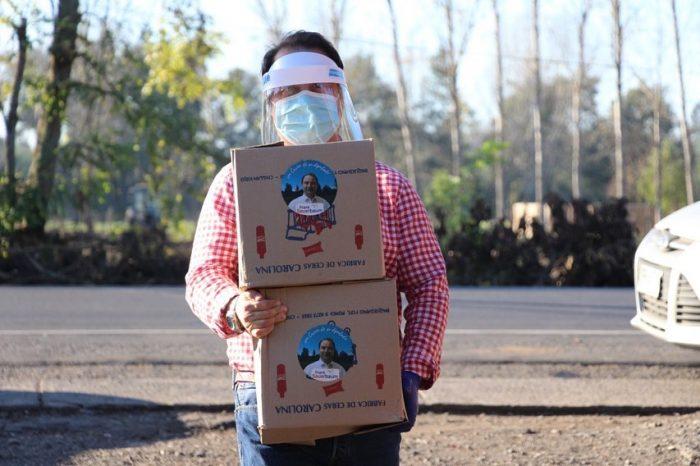 Comisión de Ética no sancionó a diputado RN por repartir cajas de comida con su foto